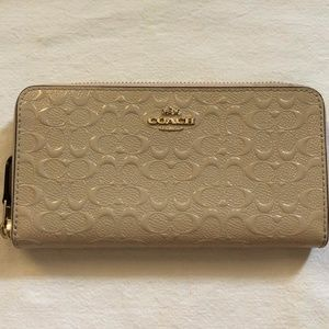 Coach Signature Debossed Accordion Zip Wallet